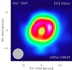 First-light observations by the GREAT H-channel on SOFIA: map of planetary nebula NGC 7027 in the neutral oxygen emission line at 63 microns. The effective angular resolution is indicated by the gray circle at lower left.