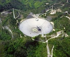 Arecibo 305 m radio telescope, located in a natural valley in Puerto Rico.
