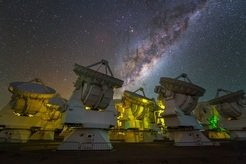 <p><em>The central region of the Milky Way above the antennas of the ALMA observatory. The direction to the Galactic center is halfway between Antares, the brightest star visible in the picture and the tip of an ALMA antenna in the foreground (second from right).</em></p>