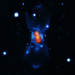 This picture shows the remains of the new star that was seen in the year 1670. It was created from a combination of visible-light images from the Gemini telescope (blue), a submillimetre map showing the dust from the SMA (yellow) and finally a map of the molecular emission from APEX and the SMA (red).