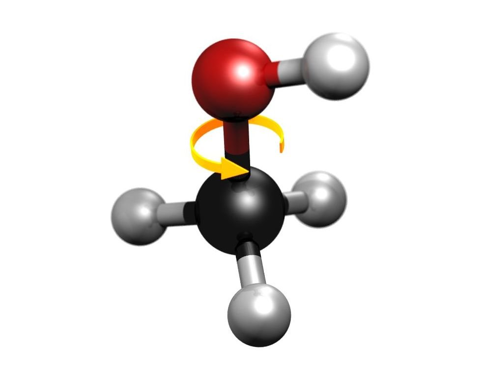 Schematic image of the methanol molecule. The black sphere represents the central carbon atom, the red one an oxygen atom and the grey spheres represent hydrogen atoms. The yellow arrow represents the internal rotation of the molecule, whose impediment causes a quantum tunnel effect.