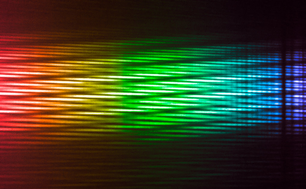 "Four-telescope interferogram of the star Sirius recorded at ""First light"" observations on 18 February 2018 with VLTI-MATISSE. This image is a colourised version of the interferogram recorded at infrared wavelengths. Blue colour corresponds to short infrared wavelengths, red corresponds to long wavelengths. The colours illustrate the changing wavelengths of the data. Interferograms are the raw data required for reconstructing high-resolution images of astronomical objects."