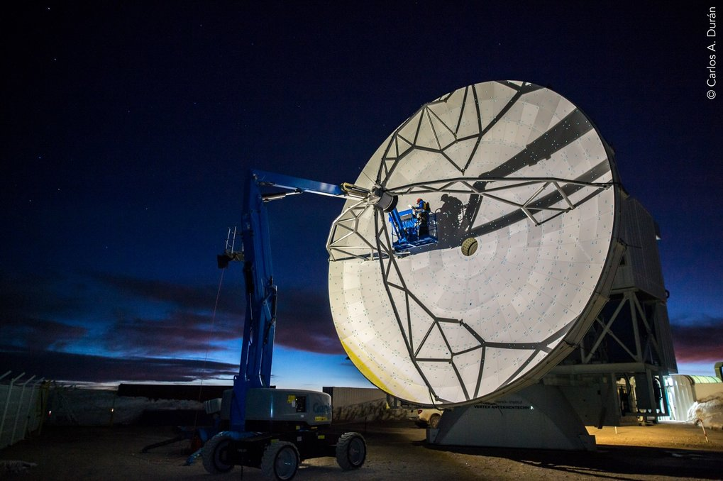 The 12-m Radio Telescope APEX at the Chajnantor plateau in Chile, which participated in the observations of 3C 279.  In the picture, the holography team is adjusting the antenna surface in order to increase the surface accuracy of the dish.